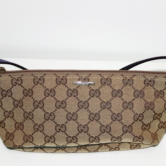78797163ca82dd Gucci Bags | Monogram Gg Signature Wristlet Pouch | Poshmark